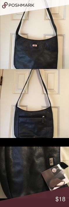 """Purse. """"Leather """" The SAK never used in excellent condition, strap is 29 inches long , measuring 11 1/2 wide 9 inches high 3 1/2 inches across the bottom. 3 different departments and inside zipper, lots of room to separate things. Saks Fifth Avenue Bags Shoulder Bags"""