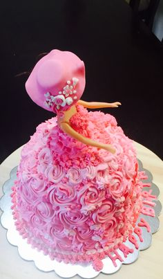 Eggless chocolate barbie cake icing with whipped cream and hat made with fondant ,decorated with mini flowers and pearls