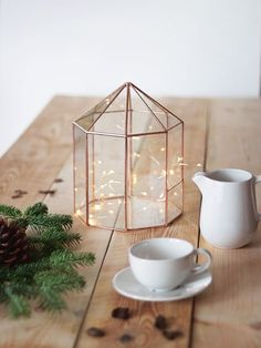 Fill this sweet glass house with string lights, or your favorite ornament, or little treasures that deserve to be the center of the table's attention.Waen Table Centerpiece, $135, available at Etsy.  #refinery29 http://www.refinery29.com/2016/11/130863/etsy-holiday-decorations#slide-4