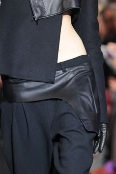 Peeks of the hip bone mirroring the leather draw on the pants, fun play with negative and positive spacial recognition