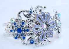 Hey, I found this really awesome Etsy listing at https://www.etsy.com/listing/187598599/frozen-snowflake-bracelet-cuff-queen
