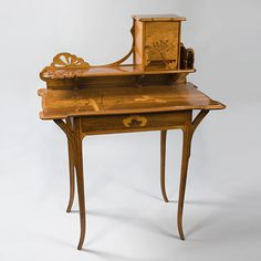 """A French Art Nouveau lady's writing desk, """"Aux Ombelles,"""" by Emile Gallé, featuring fruitwood marquetry depicting a landscape with ombelles carved in a pierced top. Examples of Gallé's """"ombelles"""" furniture are pictured in: The Paris Salons 1895-1915, Vol. III: Furniture, by Alastair Duncan, Woodbridge, Suffolk: Antique Collectors' Club, 1996, pp. 233-234."""