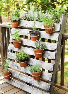 Attach clay pots to a pallet (yes, we love a pallet!) with nails and stainless steel cable ties for a living art display that keeps your rosemary and basil at the ready. Good Housekeeping Lab tip: Space out the pots so your plants have room to grow. Click through for more DIY container gardening ideas.