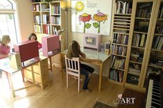 I like the individual bookcases on top of the desks. I also like the decoration on the whiteboard!
