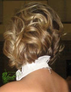 curled textured half up do on short hair