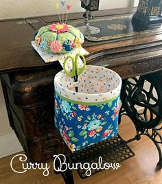 Cuteness Overload! Handmade Thread Catcher with Detachable Yo-yo Pincushion. These make fabulous gifts for anyone who sews, quilts or does any variety of needlework.