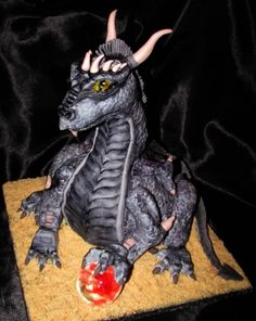 Dragon cake.  Now this is super cool!  Especially the blown sugar ball in the one claw.  I need to brush up on my carving skills.