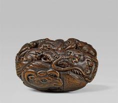 A Nagoya school ryûsa manjû-type wood netsuke of the twelve zodiac animals, by Masahiro. Mid-19th century, Auktion 1092 Asiatische Kunst I Indien, Südostasien und Japan, Lot 565