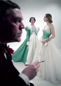 Norman Hartnell with models wearing his designs, 1953. Photo by Norman Parkinson.