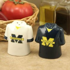 """Michigan Wolverines Gameday Ceramic Salt & Pepper Shakers by The Memory Company. $15.95. Approximately 3"""" x 2.5"""". Imported. Ceramic salt and pepper shakers. Team colors and logo. Officially licensed collegiate product. Hand painted. These fun Gameday jersey salt and pepper shakers are perfect for tailgating or watching the big game at home. The ceramic jersey backs are clearly listed as salt or pepper, so there won't be any game day personal fouls!. Save 34% Off!"""
