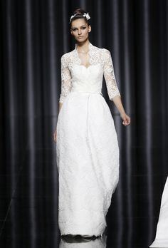 Brides: Pronovias - Fall 2012. Lace A-line wedding dress with a Queen-Anne neckline and three-quarter sleeves, Pronovias