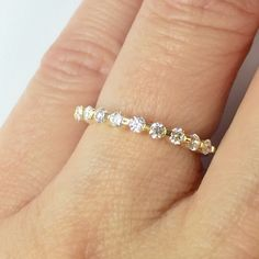 The sleek and high polished 14k gold band with brilliant diamonds creates a look that every bride desires to flaunt.