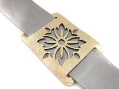 Leather cuff bracelet in silver and gold - laser cut womens cuff. $38.00, via Etsy.