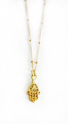 Gold Hamsa Necklace van keijewelry op Etsy, $40.00 I seriously love hamsas! Have to find one in rose gold!