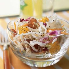 Poppy Seed Fruited Slaw. Adding a pop of fruity flavor, grapes and oranges prove that they're the life of the party in this nutty cabbage slaw.  http://www.myrecipes.com/recipe/poppy-seed-fruited-slaw-10000001227916/