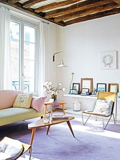 The lavender rug is to die for.....Love the white with pops of color in pastels in contrast with the wood ceiling.