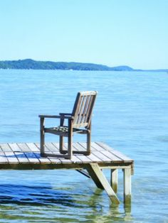 Love to sit in that chair and have a cup of coffee, looking out at the lake