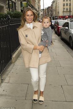 Fashion parade: Sam Faiers looked like a super chic mum as she carried her cute son Paul Tony around London on Monday as she headed to meetings