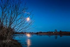 Full Moon Over The River - The full moon shines on a clear spring night at the Northern Finland. The moonlight reflects on the still water of the river. Clear Spring, Community Logo, Over The River, Full Moon, Finland, Moonlight, Sunset, Night, Amazing Places
