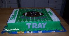 "Football Birthday Cake - 11x15 yellow sheet cake for a 14 year old.  The football is fbct, the word touchdown is royal icing painted over with dust; ""Tray"" is gumpaste painted over with dust."