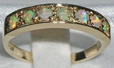 English 9K 9ct Yellow Gold Fiery Opal Eternity Anniversary Ring - Made in England - Supplied in Your Finger Size. $240.00, via Etsy.