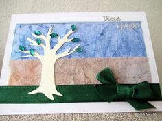 Handmade card with water colour paper pieces and a tree cut-out with stones