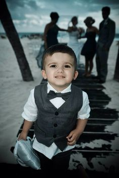 Cutest ring bearer. Grey toddlers linen suit. Beach wedding