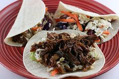 Slow cooker shredded Korean beef tacos. Holy yes.