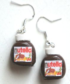 these earrings feature a pair of handmade nutella jars made from polymer clay. the miniature jars measure 1.2 cm x 1.5 cm and is securely attached to silver tone nickel free posts.