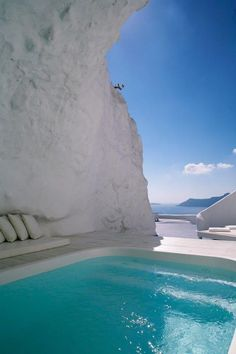Katikies Hotel Cave Pool, Greece This Greek hotel pool boasts crystal-clear water and views of the sea from the confines of a white concrete cave.
