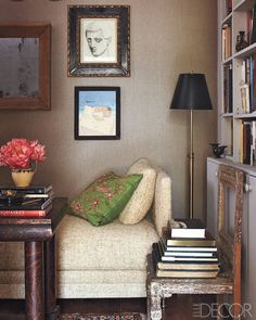 The walls in the  library are covered in linen, and a Jules Leleu daybed from the 1950s is upholstered in a Wolf Home silk.    - ELLEDecor.com