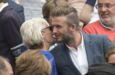 Andy Murray's mother Judy greeted David Beckham, who was at the championships with son Rom...