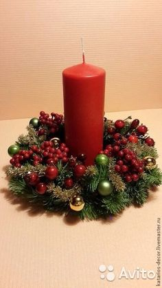 Christmas wreath on the table with a candle . Christmas Flower Arrangements, Christmas Flowers, Christmas Candles, Christmas Centerpieces, Christmas Wreaths, Christmas Crafts, Christmas Ornaments, Christmas World, Christmas Time