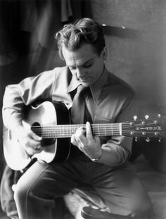 James Cagney playing a Martin guitar.