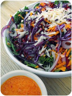 Rainbow salad with kale and orange red pepper dressing.   In Vegetables We trust