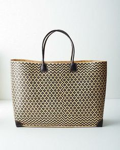 Handcrafted by artisans in Madagascar, this one-of-a-kind tote boasts an African pattern and leather trim. Large and roomy, it's the perfect shopper, beach bag, or anywhere tote