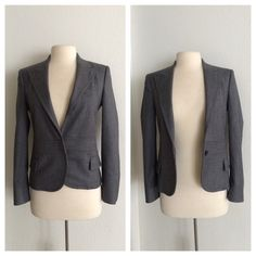 "Gucci gray blazer (Euro 40) Gucci blazer. Made in Italy. Size 40- converts to a U.S. size 8. Please see measurements! Measures 24"" long with a 36"" bust. The front has a one button and hit enclosure and two functional pockets. This does not come with a belt. The shoulders are lightly padded. This is in excellent used condition. The button is slightly loose and needs to be tightened up. The shell is 98% wool/ 2% elastane. The lining is 57% viscose and 43% polyester. No trades. Poshmark onlyI…"