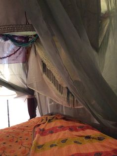 Inside the Boho Bed front view- vintage scarves and shawls. Match sheer fabric and white curtains color scheme. Add purples for color.