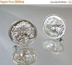 These #vintage earrings are unique and wonderful!  They feature a large mirror finish silvertone coin depicting the water nymph Arethusa of Syracuse, surrounded by dolphins ... #ecochic #etsy #jewelry #jewellery #holiday2014etfs