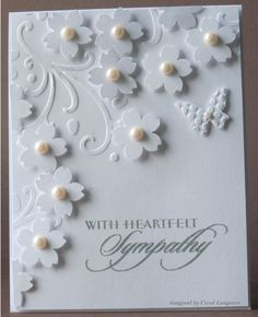 handmade card ... sympathy ... all white ...  like all the small punched sacura blossoms with pearl centers ...
