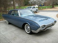 1961 Ford Thunderbird  My mom had a white one. What memories!!