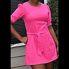 The pink vintage mini dress Medium in size. Comes with a belt. Short sleeve style. No brand Dresses Mini