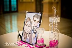Caricatures framed of Indian bride and groom at wedding reception via IndianWeddingSite.com
