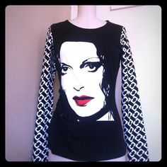 HOST PICK! DVF WARHOL long sleeve shirt! NWT Size Medium NWT DVF Andy Warhol long sleeve shirt. Iconic DVF printed sleeve with a skill screen of an Andy Warhol image of DVF . Purchased it at the journey of a  dress exhibit in Los Angeles. Features rouching on the side panel great way to accentuate the waist Diane von Furstenberg Tops