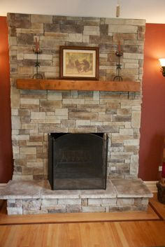 Ledge Stone Fireplace. Stone veneer applied directly over brick and a spruce beam mantel. Rich earth tone colors with hints of charcoal and burgundy. Project in Gurnee IL. www.northstarstone.biz call 847-996-6850