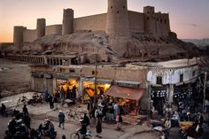 Herāt Citadel, Afghanistan. It dates back to 330 BC (rebuit many times), around the time Alexander the Great was in the area. Photo by Steve McCurry - check out his other photos from Afghanistan on the link - they're awesome.