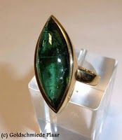 Golden ring with big tourmaline