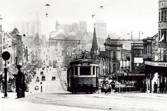 A tram travels up William Street towards Kings Cross, Sydney in the 1930s. NSW Australia