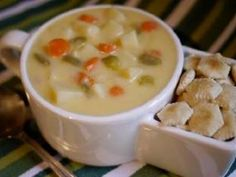 Hearty Cheddar Chowder  A hearty chowder of cheddar cheese, potatoes, carrots, bell peppers, and more.