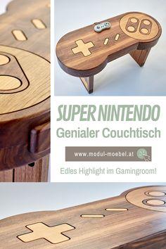 Gratuliere! Mit diesem genialen Couchtisch in Super Nintendo Stil hast du endlich das perfekte Möbel Highlight gefunden, nachdem du immer gesucht hast. Aus edlem Massivholz und auf höchstem Niveau in unserem österreichischen Tischlermeisterbetrieb verarbeitet, ist dieser exklusive Tisch aus Holz ein ganz besonderes Must-Have für alle Gamer und Retro Nerds. Individuelle Anpassungen sind unsere Spezialität. Auch als Wandbild aus Holz erhältlich. #mmw #gaming #supernintendo #holzmöbel Super Nintendo, Kitchen, Home, Patio Tables, Guy Rooms, Playroom Table, Made To Measure Furniture, Types Of Wood, Wood Ideas